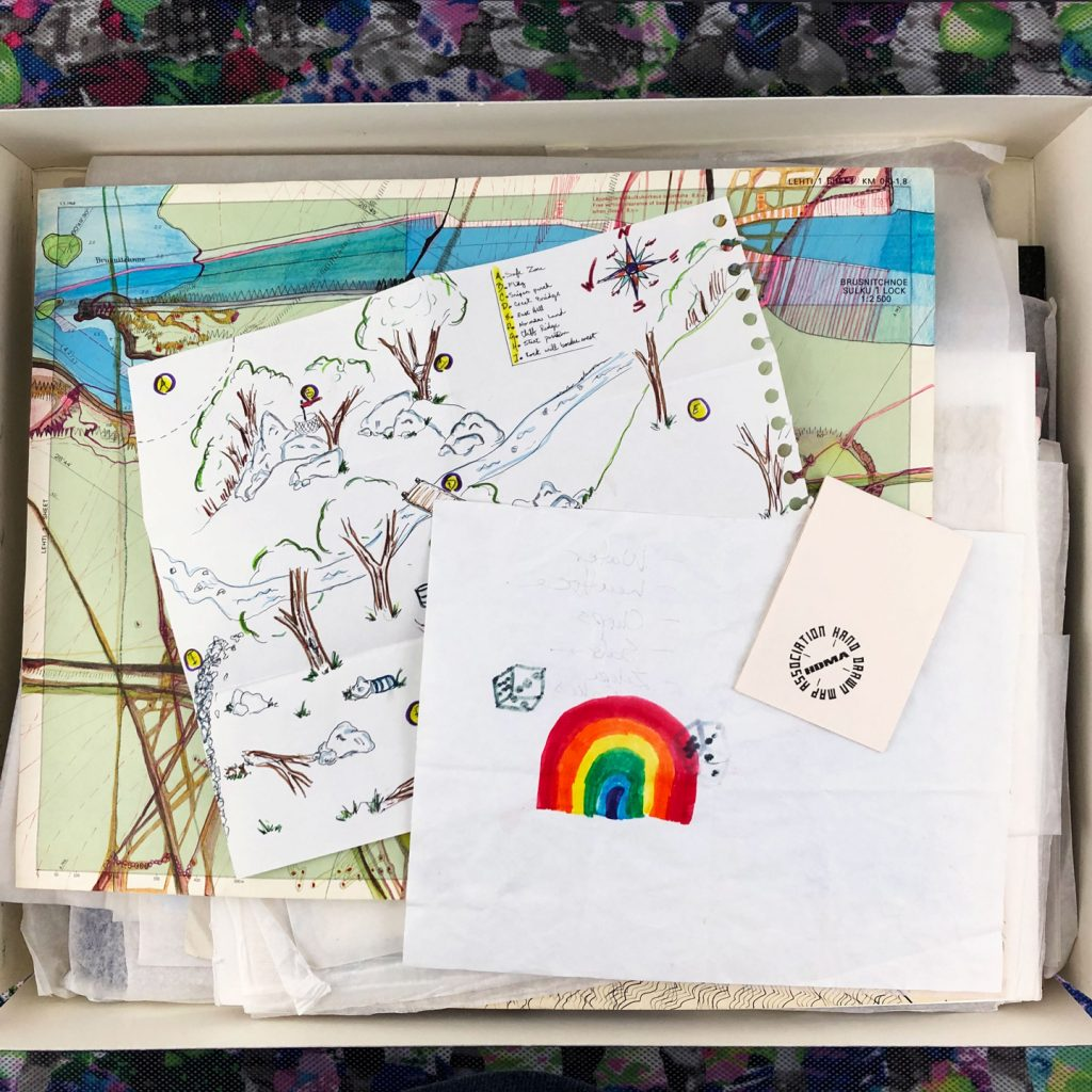photograph of hand drawn maps in an archival box